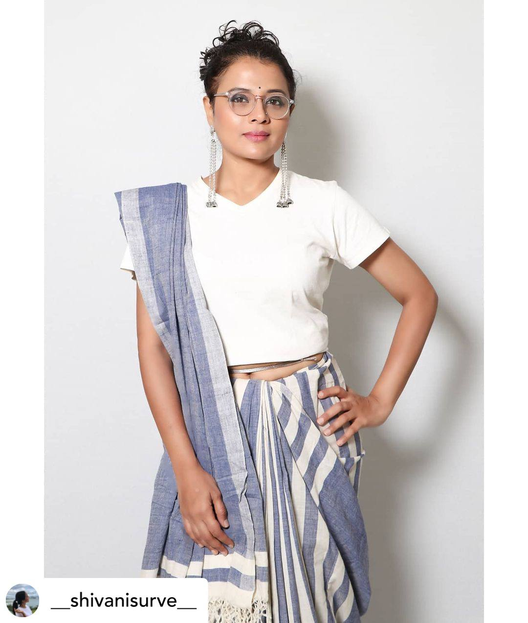white blouse grey saree standing look