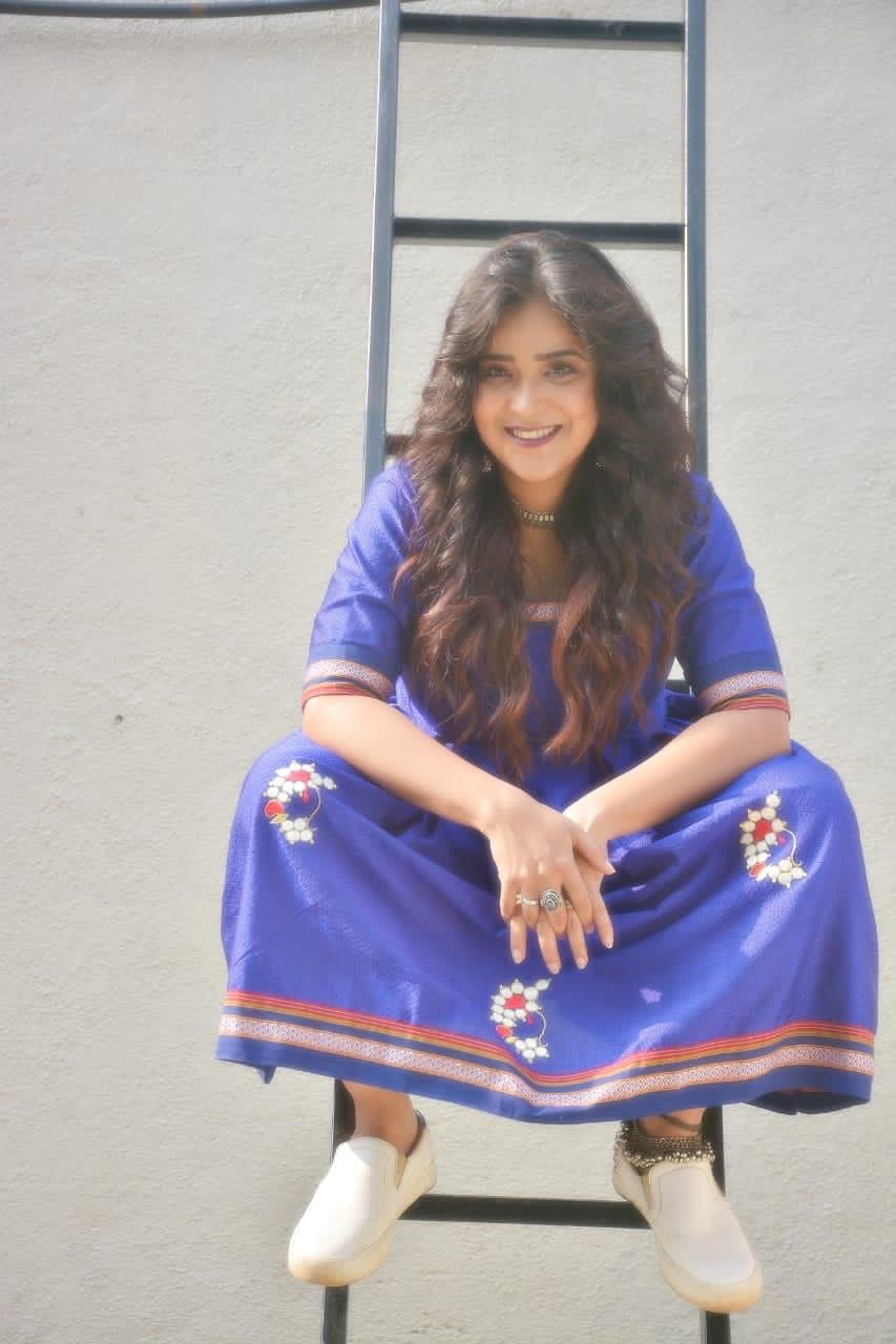 Neha blue dress sitting