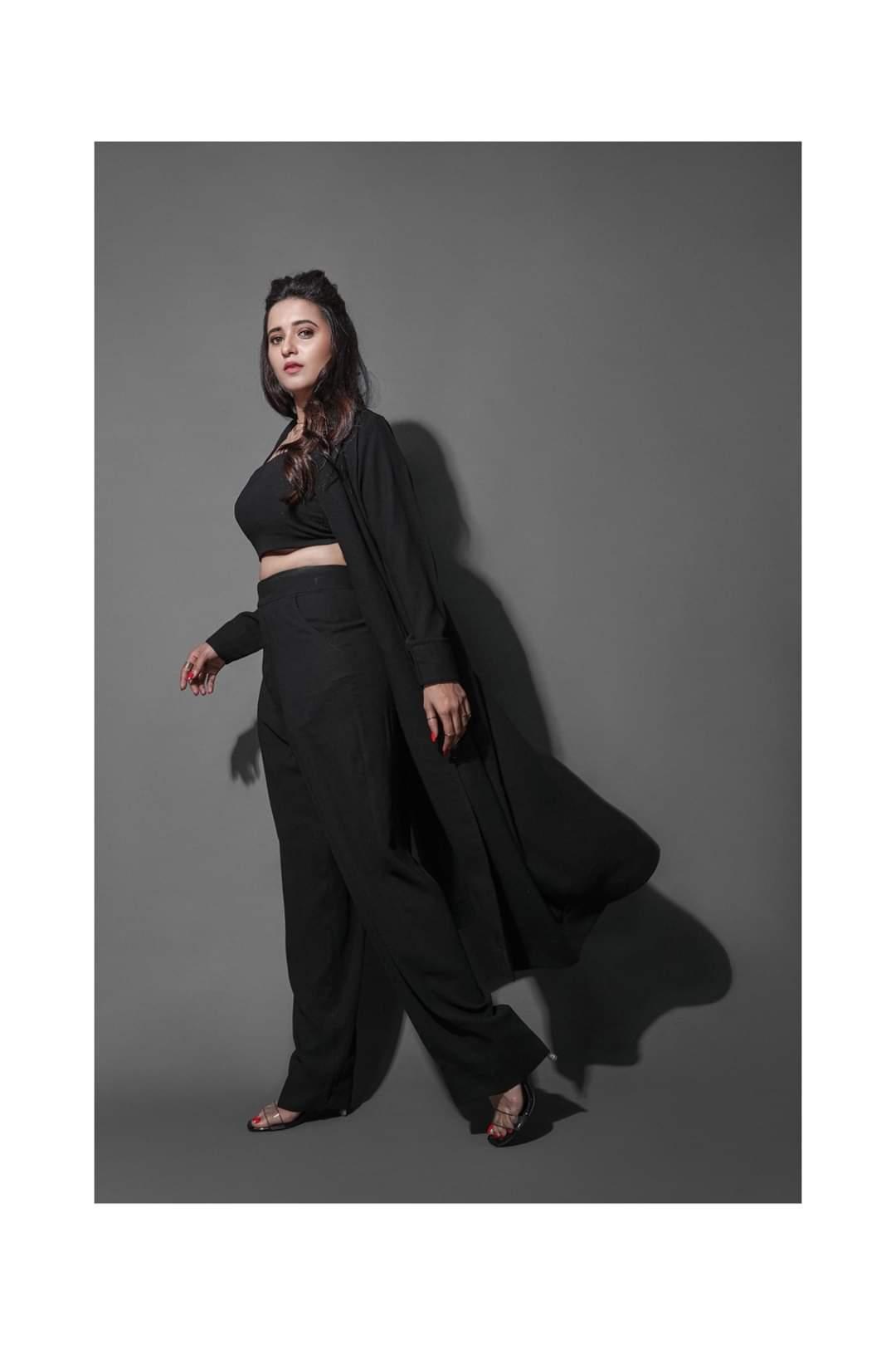 Shivani black standing-min